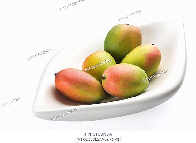 Close-up of a bowl of mangoes