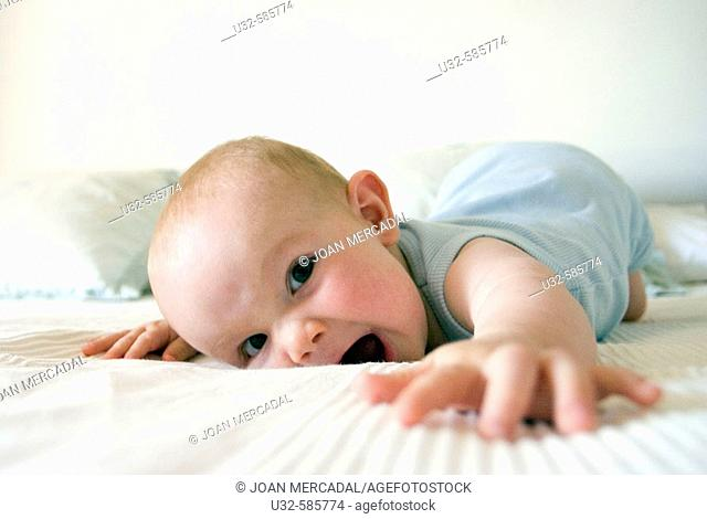 Happy baby on bed