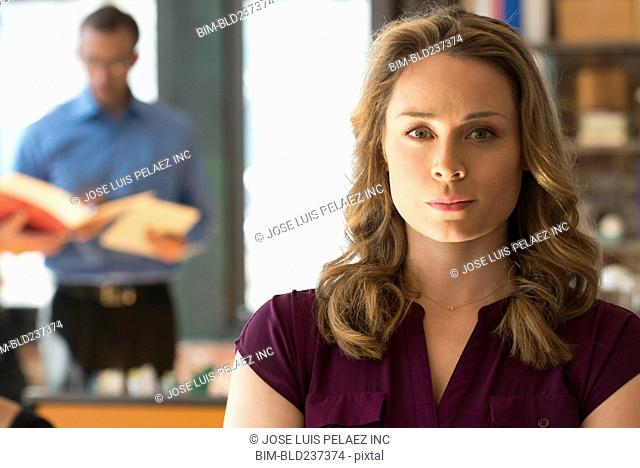 Portrait of serious Caucasian businesswoman in office