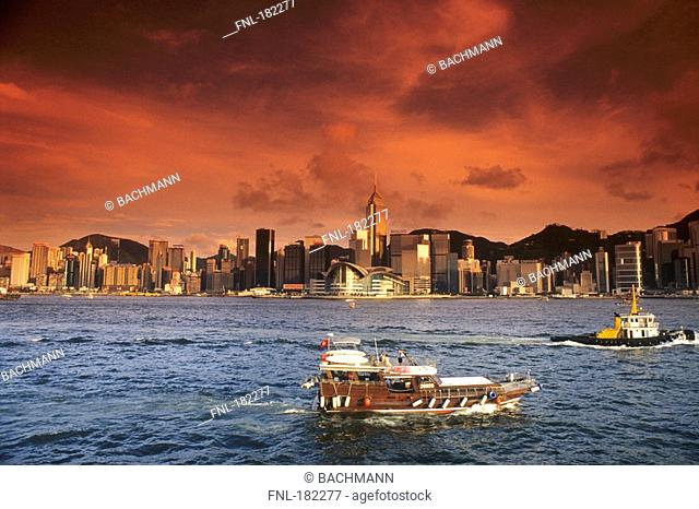 Storm clouds over harbor at dusk, Victoria Harbor, Hong Kong, China