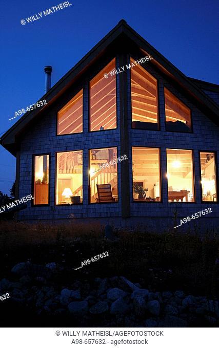 Nova Scotia Canada, illuminated wooden summerhouse at dawn