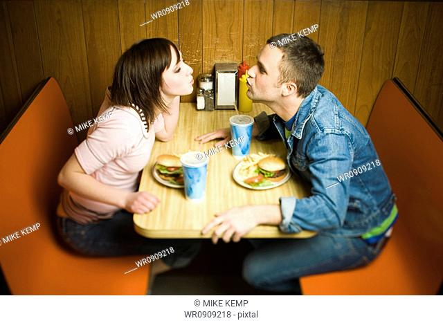 Couple on a date eating hamburgers