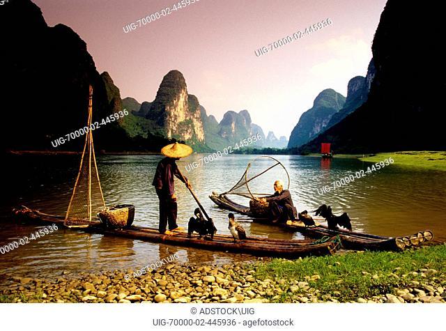 Li River, Guangxi, China: Cormorant fishermen on their bamboo rafts at rest along river near Xingping Guilin area