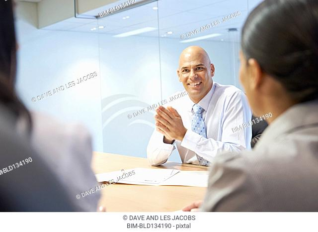 Mixed race business people talking in meeting
