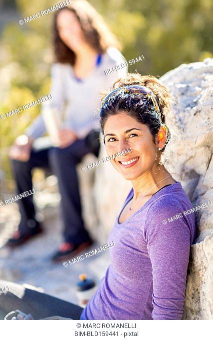 Hiker smiling on rocky hillside