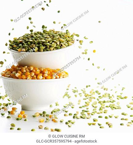 Close-up of bowls of green lentils and corn kernels