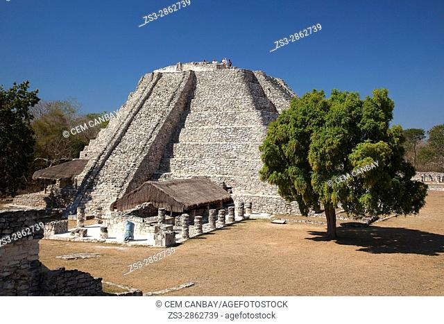Visitors at the top of the Castle of Kukulcan-Castillo de Kukulcan in Mayapan Archaeological site, Merida, Yucatan State, Mexico, Central America