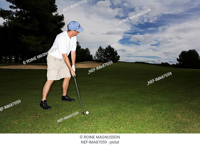 Male golfer on golf course