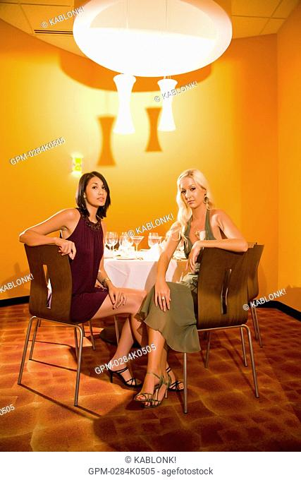 Portrait of young sexy women in restaurant