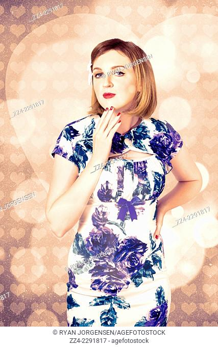 Creative old fashion portrait of a romantic girl wearing floral dress thinking up dreams of romance on valentines day design background
