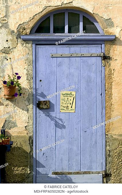 St Veran, the highest village in Europe - Old painted wood door of a house in the village