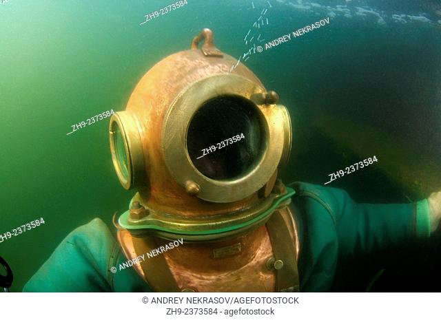Professional diver rises by a surface. Japan sea, Far East, Primorsky Krai, Vladivostok, Russian Federation