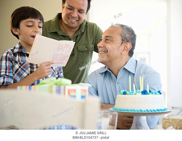 Hispanic grandfather, father and son celebrating birthday