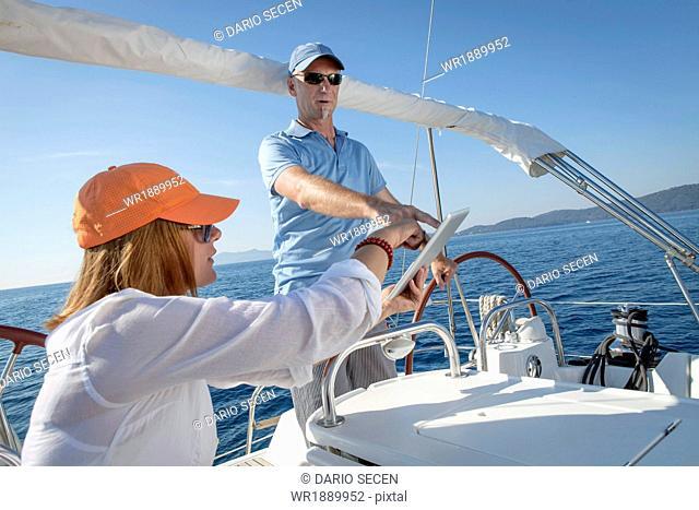 Mature couple sailing together, Adriatic Sea, Croatia