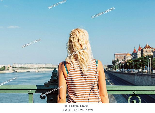 Caucasian woman standing on bridge