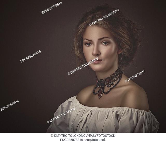 Grungy female portrait. Retro styled classic dramatic light