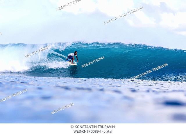 Indonesia, Bali, man surfing