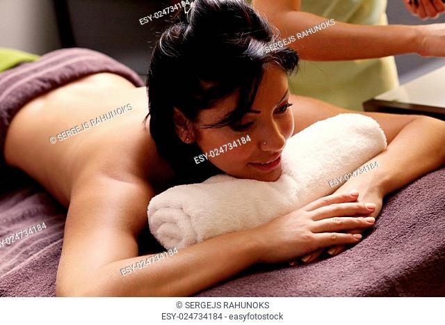 Beauty, health. Attractive girl in spa salon