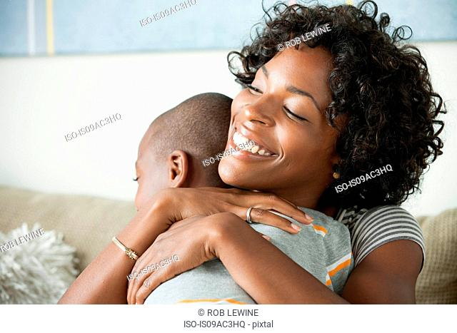 Portrait of mother hugging son