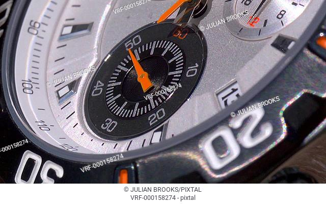two second hands on a chronograph working together, speeded up, seamless loop