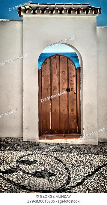 Doorway en route to â. ªâ. ŽPlaya el Salon in Nerja,â. ¬. Costa del Sol, Malaga Province, . Andalucia, Spain