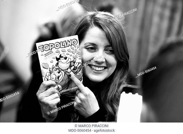 The singer Noemi (Veronica Scopelliti) smiling holding a copy of Topolino at the 66th Sanremo Music Festival. Sanremo, Italy. February 2016