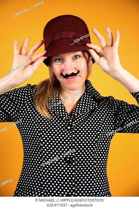Woman wearing fake moustache