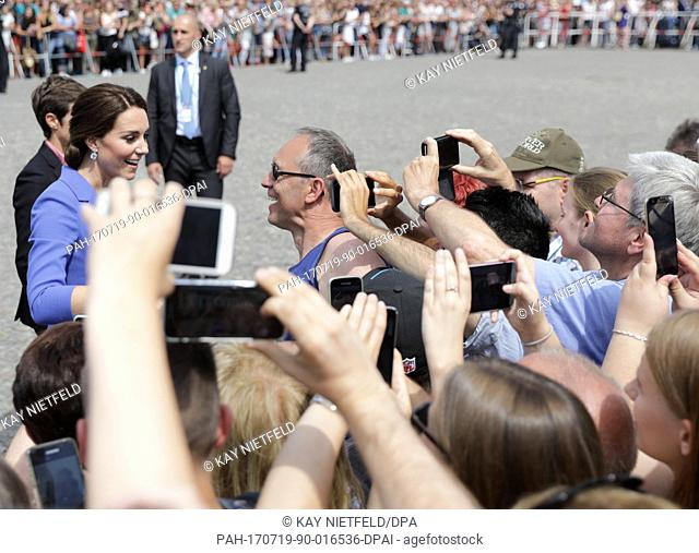 Catherine, Duchess of Cambridge, chats with spectators during a visit to the Brandenburg Gate in Berlin, Germany, 19 July 2017