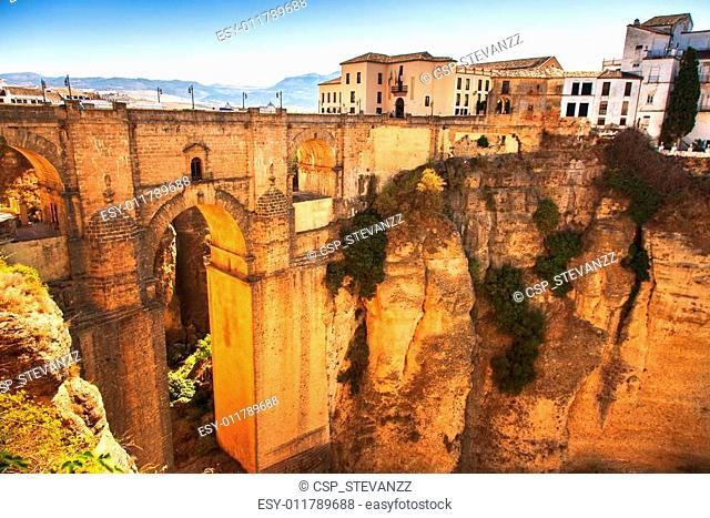 Puente Nuevo or New Bridge historic landmark and el tajo gorge in Ronda, white village building on the rocks. Andalusia, Spain