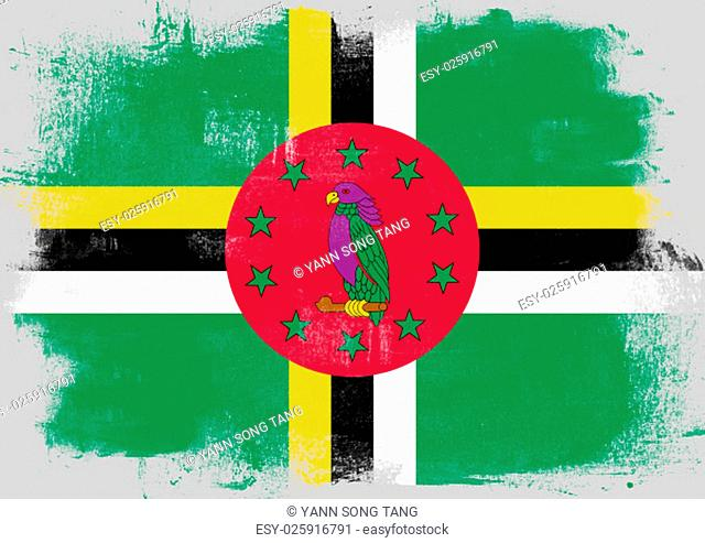 Flag of Dominica painted with brush on solid background