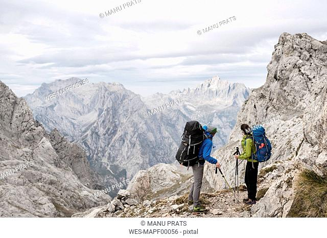 Spain, Picos de Europa, mountaineers in mountainscape