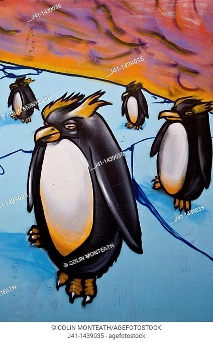 Street art, graffiti, crested penguin on ice with global warming threat on horizon, Christchurch, New Zealand