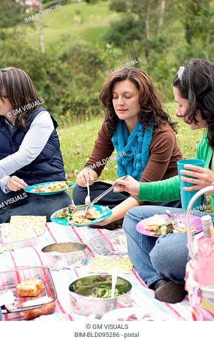 Hispanic woman enjoying picnic