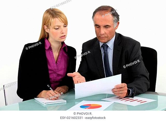 Businesspeople discussing charts