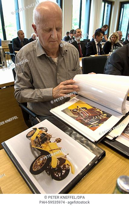 Convicted triple murderer Roland S. shows photographs and drawings of his model cars as he testifies as a witness before the 'model car' investigation committee...