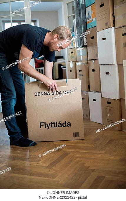 Man unpacking box