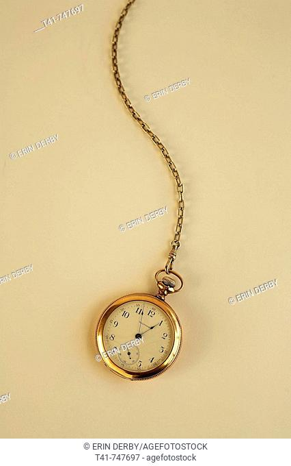 An antique, brass pocket watch showing the hands of time