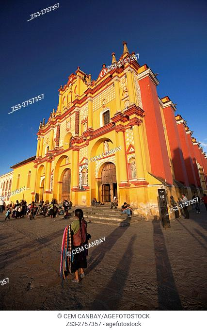 Indigenous vendor in front of the Cathedral of San Cristobal, San Cristobal de las Casas, Chiapas State, Mexico, Central America