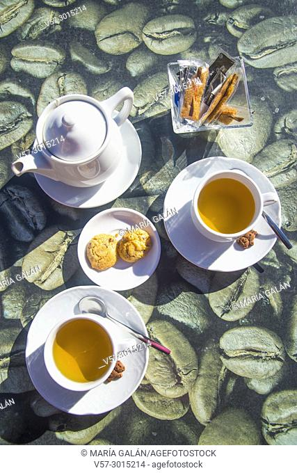Two cups of tea with biscuits. View from above