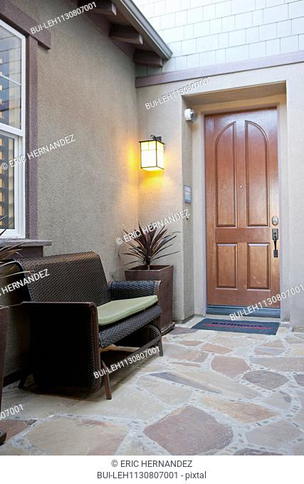 Seating furniture on porch; Valencia; California; USA