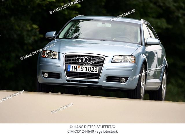 Car, Audi A3 Sportback 2.0 TFSI, model year 2004-, hatchback, Lower middle-sized class, silver-blue moving, diagonal from the front, frontal view, country road