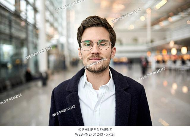 Portrait of confident young businessman wearing glasses