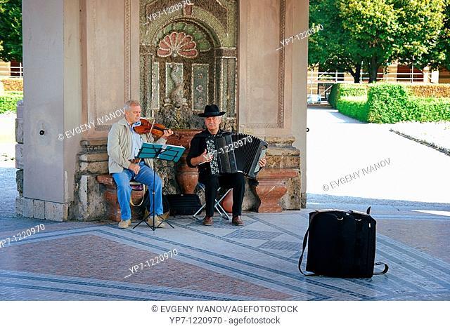 Street musicians in Pavilion for the goddess Diana Dianatempel in Court Garden Hofgarten in Munich