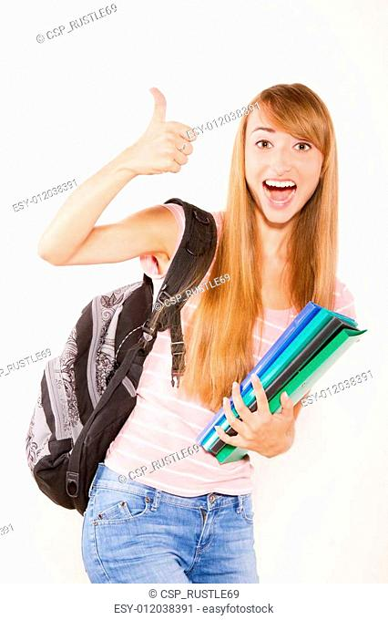 Smiling female student with books in hands