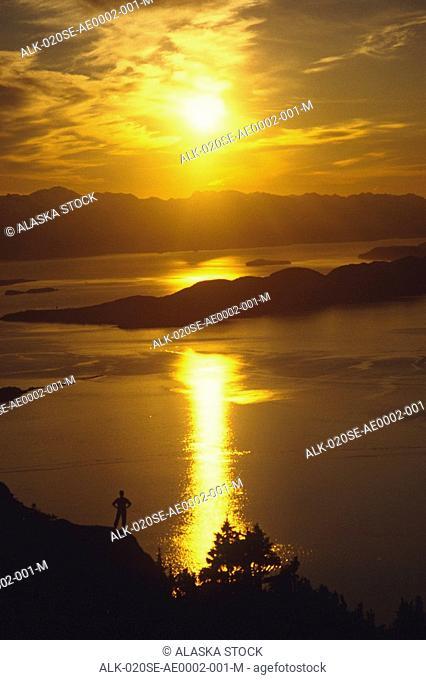 Hiker at sunset Lynn Canal Douglas Island Southeast Alaska Silhouette Inside Passage