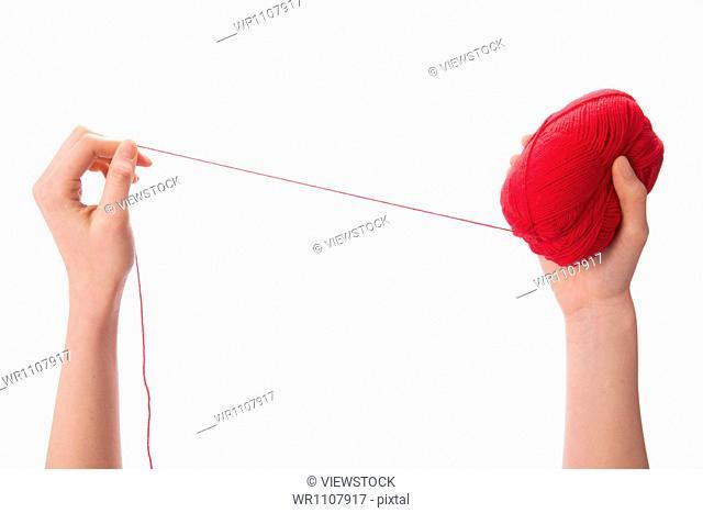 Woman holding spool yarn