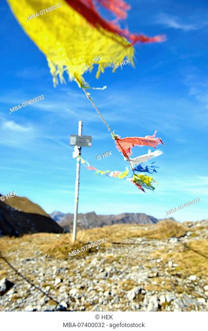 Frayed prayer flags blowing in the wind, Hahntennjoch, Tyrol, Austria, Europe