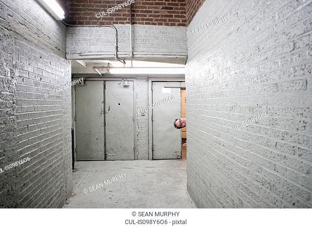 Man peeking round corner