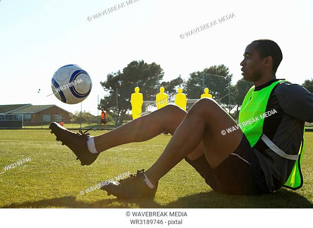 Soccer player practicing with a ball
