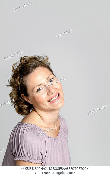 Studio shot of woman, smiling